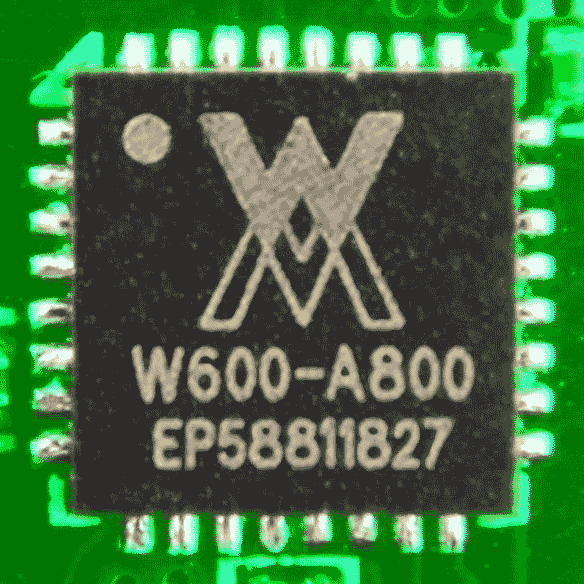 [Photo: W600 chip soldered onto a PCB]